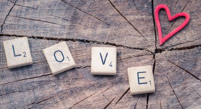 Canva - Photo of Scrabble Letter Tiles Forming the Word Love.